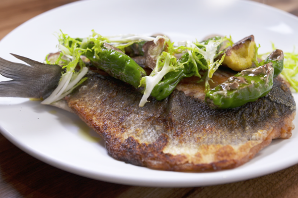 Branzino with shishito peppers, squash, and eggplant puree from Noble Fin
