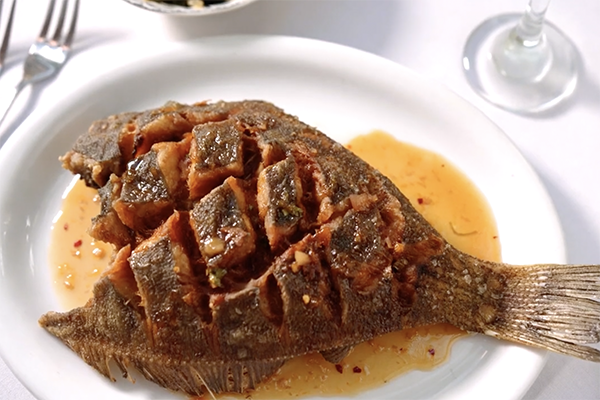 The crispy scored flounder from Olde Pink House in Savannah, GA.